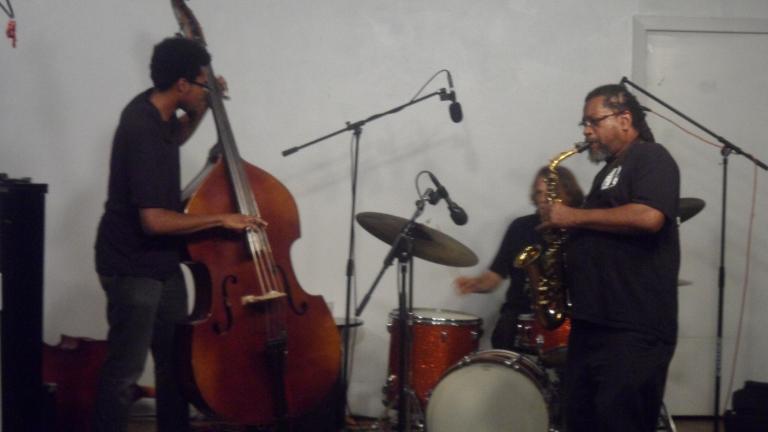 Trio-O. L to R: Luke Stewart [bass], Sam Lohman [drums] and Aaron Martin Jr [alto].